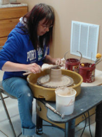 Picture of Sylvie at the pottery wheel
